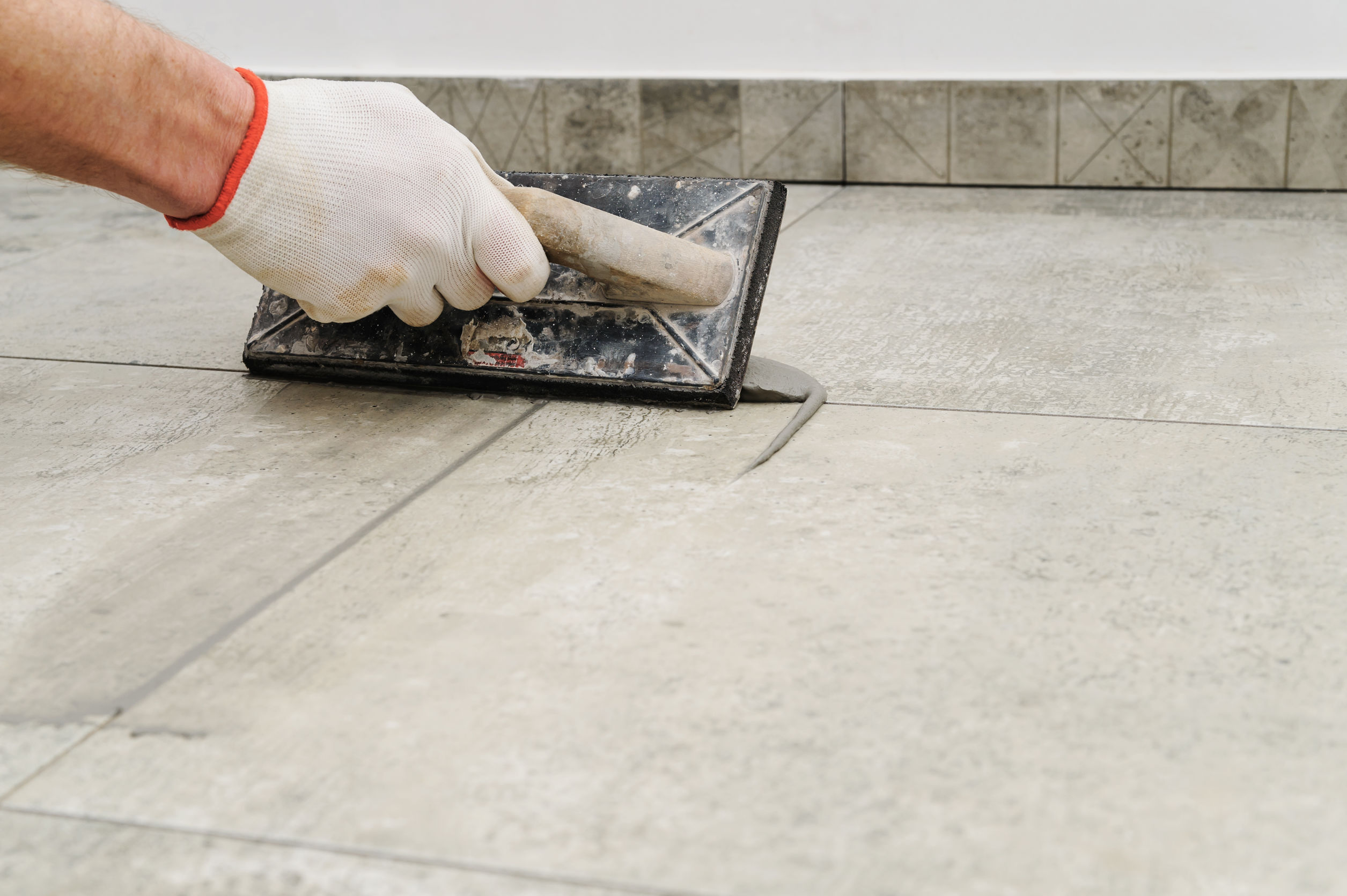 Grouting ceramic tiles.